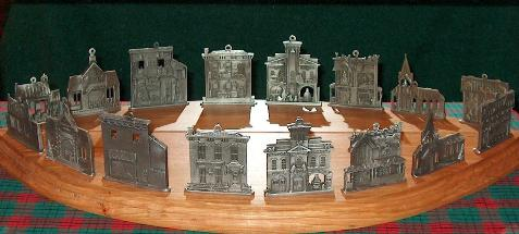 Pewter Christmas Building Display with mirror showing backside of ornaments